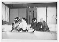 [Young man and woman each being counseled by a woman and an old man in Kabuki play, Rohwer, Arkansas, October 21, 1944]