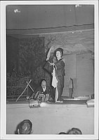 [Woman stands next to grimacing samurai in Kabuki play, Rohwer, Arkansas]