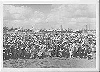 [Rows of people attending outdoor funeral in open field, Rohwer, Arkansas, September 30, 1944]