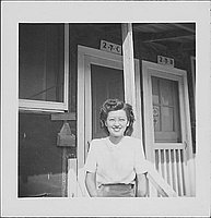 [Young woman wearing eyeglasses in front of barracks porch, 2-7-C, Rohwer, Arkansas, September 23, 1944]