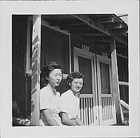 [Two young women sitting on barracks porch, 2-7-C, Rohwer, Arkansas, September 23, 1944]