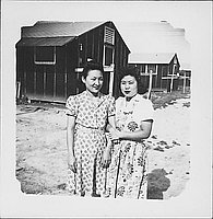 [Two women linking arms, three-quarter portrait, Rohwer, Arkansas]