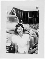 [Young woman standing in front of truck, Rohwer, Arkansas]