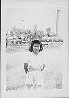 [Young woman in candy striper apron, Rohwer, Arkansas]