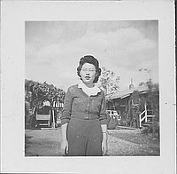 [Woman with eyeglasses and ruffled collar standing outdoors, half-portrait, Rohwer, Arkansas, November 10, 1944]