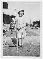 [Sakaye Nakatsuru and tree trunk, Rohwer, Arkansas, January 24, 1944/5?]