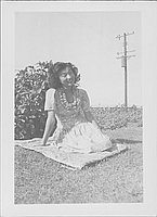 [Young woman sitting on quilt on grass, Rohwer, Arkansas, September 3, 1944]