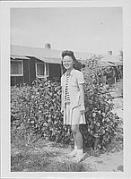 [Girl in eyeglasses and striped shirt, Rohwer, Arkansas]