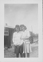[Two young women standing side-by-side, Rohwer, Arkansas]