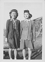 [Misako Nakatsuru and another young women standing side-by-side near barracks, Rohwer, Arkansas, January 29, 1945]