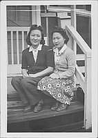 [Two young women sitting on barracks porch steps, Rohwer, Arkansas, JAN 11