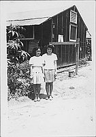 [Two girls standing in front of barracks, Rohwer, Arkansas, July 23, 1945]
