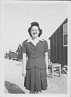 [Sakaye Nakatsuru in suit and eyeglasses, three-quarter portrait, Rohwer, Arkansas, April 28, 1945]