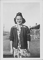[Sakaye Nakatsuru in floral print dress, sweater and eyeglasses, three-quarter portrait, Rohwer, Arkansas, January 29, 1945]