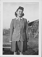 [Misako Nakatsuru in suit standing near barracks, Rohwer, Arkansas, January 29, 1945]