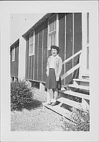[Young woman standing on barracks steps, Rohwer, Arkansas]