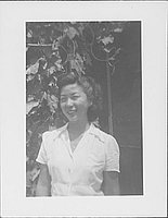 [Woman in white blouse and vines, half-portrait, Rohwer, Arkansas]