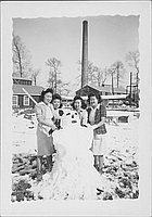 [Four women and snowman, Rohwer, Arkansas]