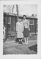 [Two women standing on wooden footpath, full-length portrait, Rohwer, Arkansas]