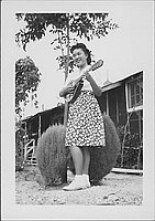 [Young woman playing a mandolin, Rohwer, Arkansas, November 12, 1944]