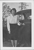 [Caucasian woman standing next to automobile, Rohwer, Arkansas, November 1944]