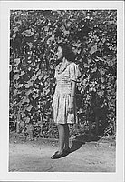 [Young woman standing in profile, full-length portrait, Rohwer, Arkansas, September 3, 1944]