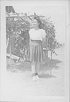 [Young woman standing in front of arbor, full-length portrait, Rohwer, Arkansas]