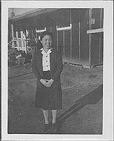 [Woman standing in front of barracks, full-length portrait, Rohwer, Arkansas]