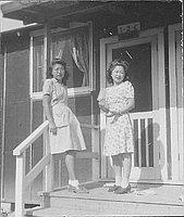 [Two young women standing on barracks porch, 1-2-C, Rohwer, Arkansas, June 5, 1945]