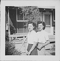 [Two women wearing eyeglasses in front of barracks porch with vine, Rohwer, Arkansas, September 23, 1944]