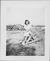 [Woman sitting on sawhorse, Rohwer, Arkansas, June 6, 1945]