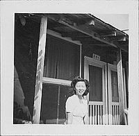 [Woman in front of barracks porch, 2-7-C, Rohwer, Arkansas, September 23, 1944]