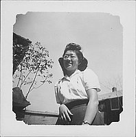 [Woman in eyeglasses leaning on elbow, half-portrait, Rohwer, Arkansas]