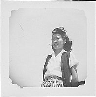 [Woman in eyeglasses, vest, and leaf-print skirt, half-portrait, Rohwer, Arkansas]