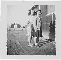 [Two women standing together next to barracks, Rohwer, Arkansas, April 1944]