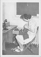 [Young woman crocheting, Rohwer, Arkansas, October 18, 1944]