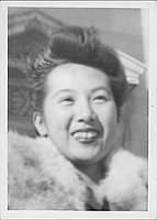 [Woman in fur stole, head and shoulder portrait, United States]