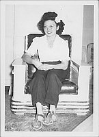 [Woman in eyeglasses and white flower in hair, seated portrait, Rohwer, Arkansas, October 29, 1944]
