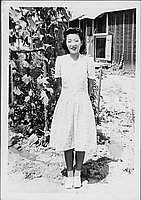 [Woman in spiral patterned dress in front of vines, full-length portrait, Rohwer, Arkansas, July 9, 1944]