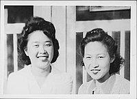 [Two women in front of barracks doors, Rohwer, Arkansas]