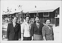 [Four women standing in front of barracks, half-portrait, Rohwer, Arkansas]