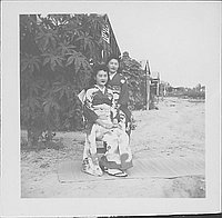 [Two young women in kimono outside on a goza mat, Rohwer, Arkansas]