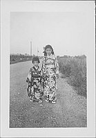 [Two girls in kimonos standing on road, Rohwer, Arkansas, August 14, 1944]