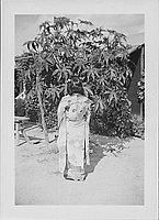[Young woman in kimono standing with back to viewer, Rohwer, Arkansas]