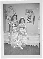 [Two young women in kimono in a bedroom, Rohwer, Arkansas]