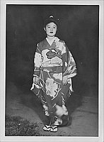 [Kimiko Yamasaki in kimono standing in darkness, full length portrait, Rohwer, Arkansas]