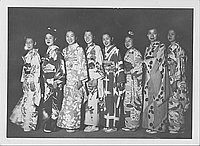 [Eight women in kimono standing in darkness, Rohwer, Arkansas]