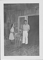 [Woman taking ticket from man at door, Rohwer, Arkansas]